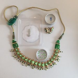 Set of bindi, necklace and earrings.